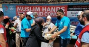 Charitable Muslims reach out to Syrian refugees with food aid