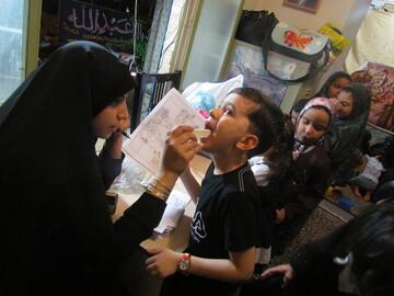 دندانپزشکی که کودکان عزادار حسینی را رایگان درمان می کند
