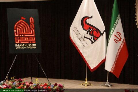 بالصور/ مراسم إزاحة الستار ملصق شعار الأربعين الحسيني في قم المقدسة