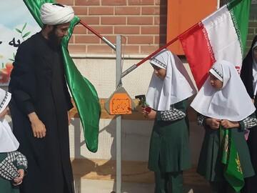 آئین بازگشایی مدارس و گرامیداشت هفته دفاع مقدس برگزار شد+ عکس
