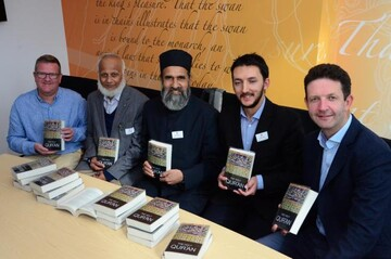 Chesham Imam presents Quran translation to county libraries