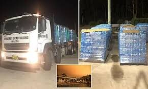 Muslim group are praised for travelling 200kms to donate 36,000 bottles of water to firefighters and bushfire victims
