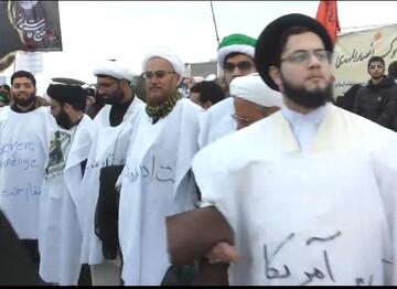 فیلم| حضور روحانیون کفن پوش قم در تشییع پیکر حاج قاسم سلیمانی