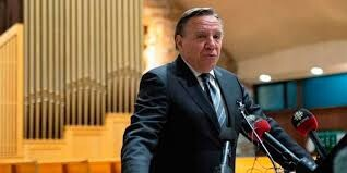 Quebec premier's facebook page flooded with anti-Muslim messages