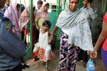 Rohingya Muslims fleeing mistreatment in Rakhine state face charges for 'illegal travel'
