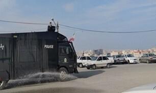 ضدعفونی محوطه مزار شهدای گمنام کوه خضر نبی قم توسط یگان ویژه انتظامی
