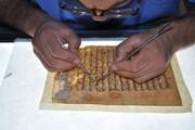 روضہ حضرت عباس(ع) میں قدیم ترین قرآنی نسخے کی مرمت + تصاویر