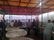 طبخ و توزیع غذای گرم بین مدافعان سلامت قزوین
