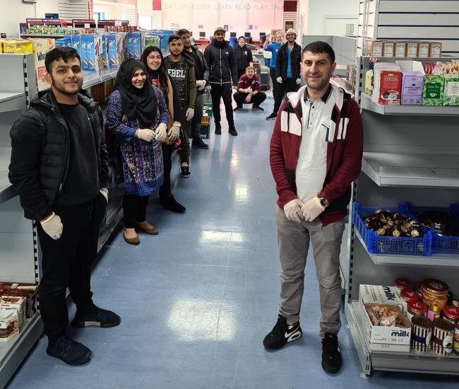 Volunteers from mosques and temples turn out in their hundreds to assist neighbours