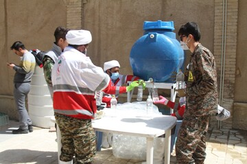 توزیع بسته های مواد ضد عفونی به همراه دعای فرج در همدان