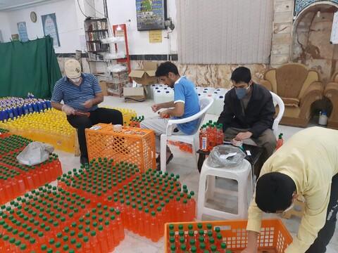 تصویر/ آماده سازی بسته های کمک مومنانه مسجدامام حسن مجتبی (ع) کوی شهیدان خاندایی کاشان