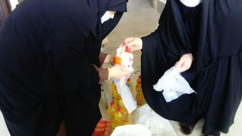 تصاویر / توزیع بستههای غذایی و دوخت ماسک به همت خواهران طلبه هشترود