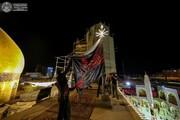 پرچم عزای امیرالمؤمنین(ع) در حرم آن حضرت برافراشته شد + تصاویر