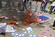 تکریم شهدای مقاومت و به آتش کشیدن پرچم رژیم صهیونیستی در عراق + تصاویر