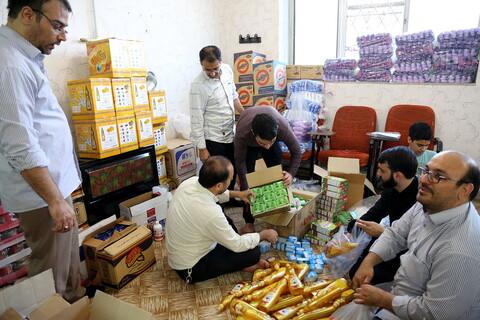 تصاویر/بسته بندی اقلام خوراکی وبهداشتی ویژه شب عید توسط قرارگاه کریمه قم تحت اشراف هیئت زینبیون