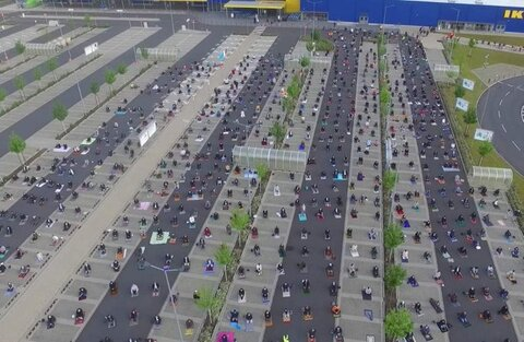 Incredible images show Muslims using an IKEA parking lot to pray safely while social distancing