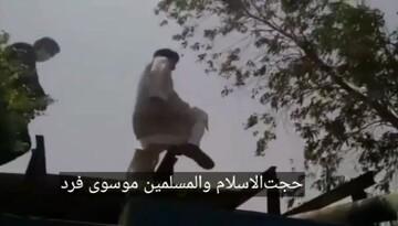 فیلم/ وقتی امام جمعه اهواز از دیوار منبع آب بالا رفت...
