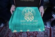 اهتزاز پرچم آستانهای رضوی و فاطمی برفراز شهر گرگان