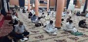 تقریر مصور عن قراءة دعاء الامام الحسین(ع) في یوم العرفة في العراق
