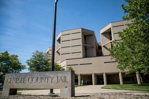 A lawsuit filed against Genesee County and two deputies alleges a Muslim woman was forced to remove her hijab in the jail.