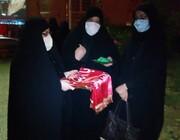 پرچم حرم حضرت زینب( س) به مدرسه خواهران اهرم رسید