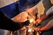 نقش بستن پرچم اسرائیل بر سطل زباله در بحرین