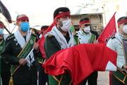 تصاویر| بر افراشته شدن پرچم حرم سید الشهدا(ع) بر فراز بین الحرمین شیراز
