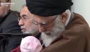 فیلم | اذان گفتن رهبر معظم انقلاب در گوش فرزند سوم شهید مدافع حرم محمد بلباسی