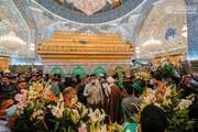 بالصور/ شاهد الضريح المقدس لأمير المؤمنين( عليه السلام) تحيطه الزهور في يوم مولده المبارك
