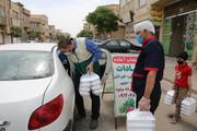 تصاویر/ تهیه و توزیع غذای گرم و بسته های تبرکی آستان قدس رضوی