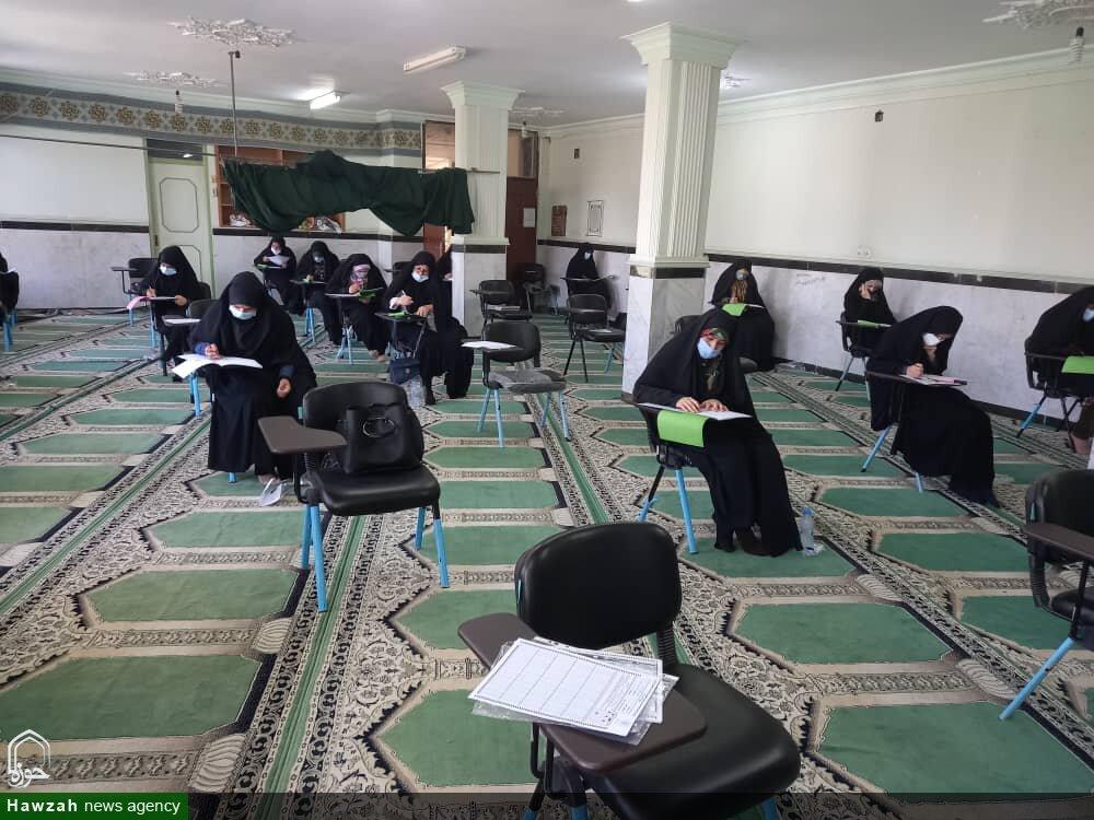 تصاویر/ آزمون کتبی اعطای مدرک تخصصی به حفاظ قرآن کریم در بوشهر
