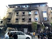 اخماد حريق بفندق وسط كربلاء وانقاذ ۷۸ نزيلاً + الصور