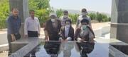 عطر افشانی گلزار مطهر شهدای گمنام شهرستان چرام توسط اعضای ستاد نماز جمعه