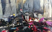 إخماد حريق داخل موكب حسيني على طريق نجف - كربلاء + الصور