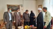 تجلیل امام جمعه بویین زهرا از خانواده شهید جاویدالاثر