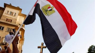الموضوع في الصورة علم مصر وصليب المسيحيين