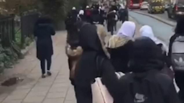 Police investigate vile footage of man hurling a torrent of racist abuse at Muslim schoolgirls wearing hijabs