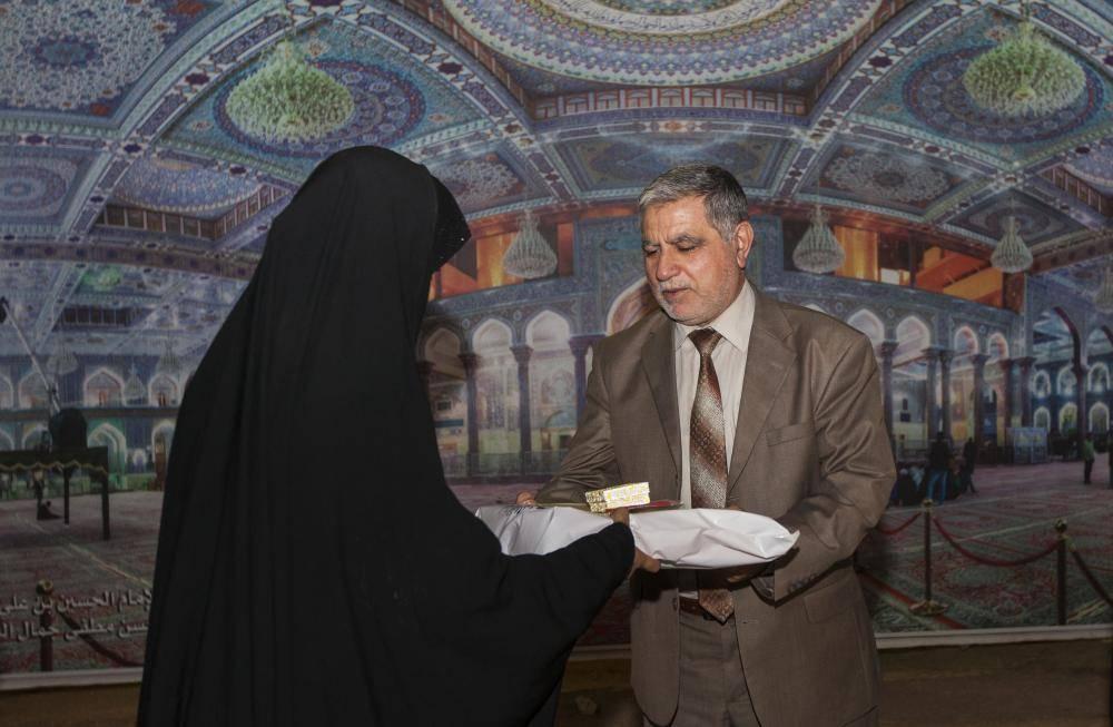 تجلیل از خانواده شهدای بسیجی عراق