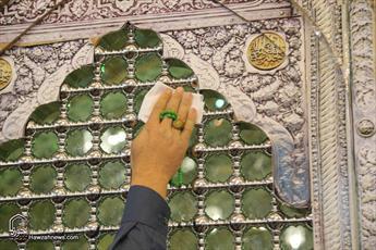 تصاویر/ مراسم غبار روبی ضریح مطهر حضرت معصومه (س)