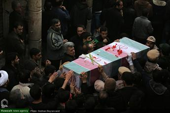 تصاویر/ مراسم تشییع و تدفین شهدای گمنام در حوزه علمیه مروی