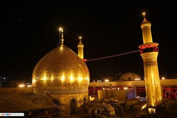 تصاویر/ تعویض پرچم حرم امام حسین (ع) با حضور میلیونی زائرین