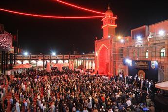 پرچم حرم امامین عسکریین(ع) با حضور شخصیت های دینی و زائرین تعویض شد+ تصاویر