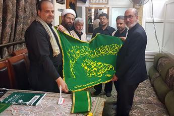 اهدا پرچم متبرک حرم حضرت معصومه(س) به عتبه علوی